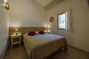 Chambre résidence mini-villas Santa Giulia